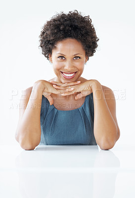 Buy stock photo Portrait of confident African American business woman smiling with hands on chin