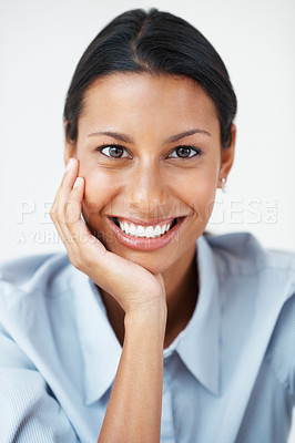 Buy stock photo Attractive female executive smiling with hand on chin