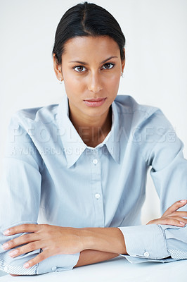 Buy stock photo Portrait of mixed race female executive with hands folded over white background
