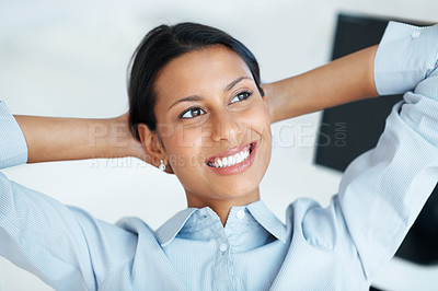 Buy stock photo Beautiful female executive relaxing with hands behind head
