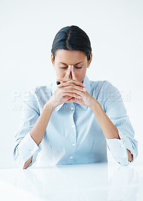 Buy stock photo Stressed business woman holding fingers at noseband