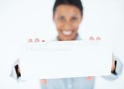 Buy stock photo Beautiful female executive showing blank card over white background