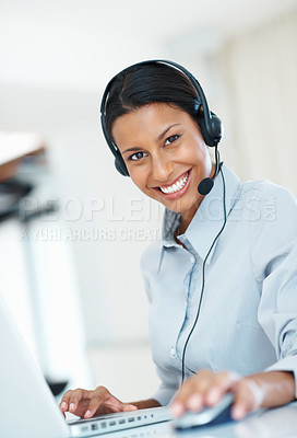 Buy stock photo Beautiful call center employee using laptop at office