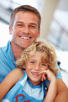 Buy stock photo Portrait of cute little boy smiling with father at home