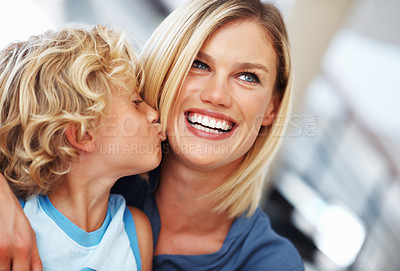 Buy stock photo Closeup of cute little boy kissing beautiful mother