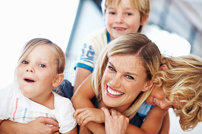 Buy stock photo Portrait of beautiful middle aged woman enjoying some playtime with her three cute kids