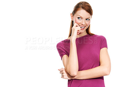 Buy stock photo Portrait of a young woman biting her finger in a coy manner