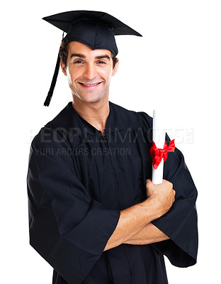 Buy stock photo Attractive young male graduate smiling at the camera with his arms folded