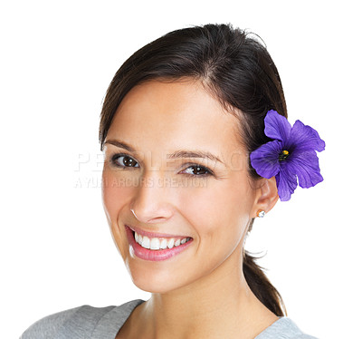 Buy stock photo Closeup of a lovely brunette smiling at the camera with a purple hibiscus flower in her hair