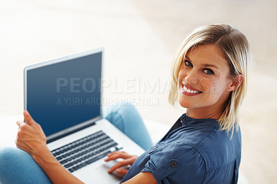 Buy stock photo Closeup of gorgeous middle aged woman smiling while using laptop