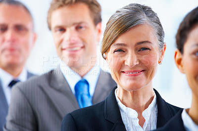 Buy stock photo Visionary business group - Mature business woman with her colleagues in the background