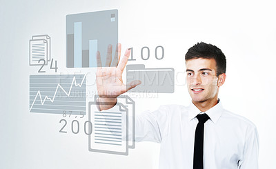 Buy stock photo A business man touching a virtual touchscreen with stats