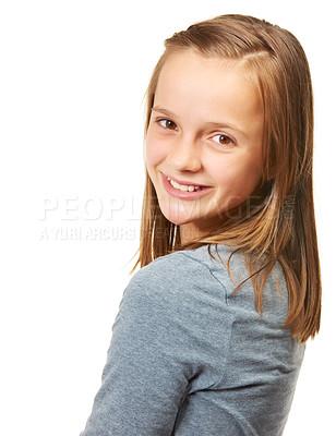 Buy stock photo Cropped studio portrait of a happy teenage girl looking over her shoulder