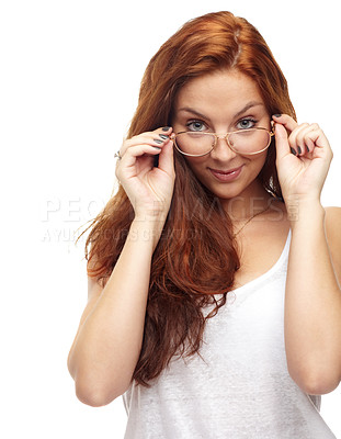 Buy stock photo Portrait of a cute young woman peering over her spectacles at the camera