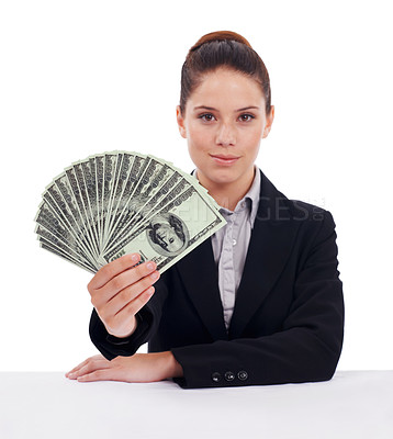 Buy stock photo Studio portrait of a young woman holding up fanned-out dollar bills isolated on white