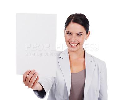 Buy stock photo Shot of a young women pointing at a small blank sign she is holding isolated on white