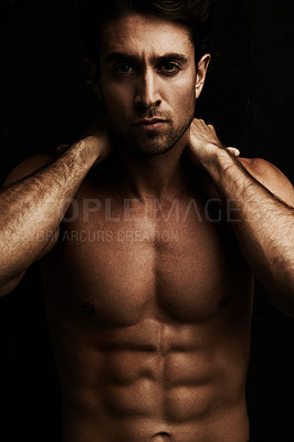 Buy stock photo Portrait of a muscular young man isolated on black