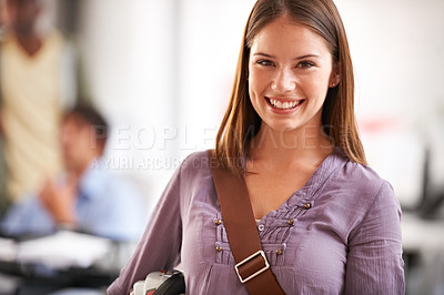 Buy stock photo Portrait of an ambitious young businesswoman smiling at you alongside copyspace