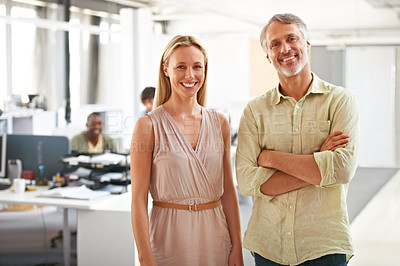 Buy stock photo Two experienced businesspeople standing together in the office