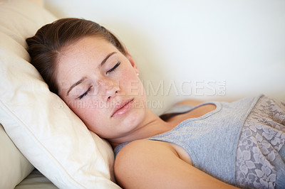 Buy stock photo A gorgeous young woman fast asleep on the couch