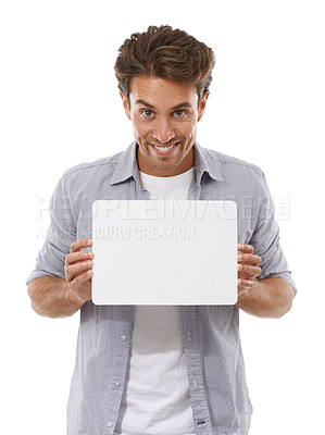 Buy stock photo Portrait of a handsome young man holding a sign for your copyspace