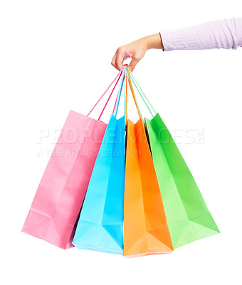 Buy stock photo Woman's hand holding colorful shopping bags over white