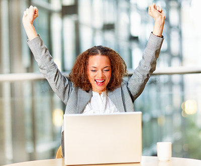Buy stock photo Excited young African American business woman working on a laptop