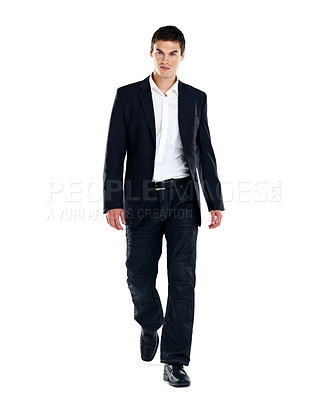Buy stock photo Portrait of a handsome young male entrepenuer walking on white background