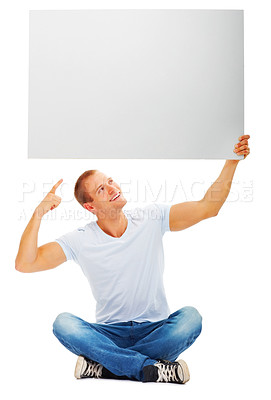 Buy stock photo Portrait of a happy male holding and pointing at blank white card