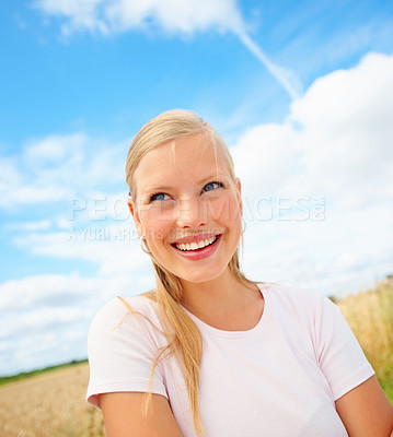 Buy stock photo Beautiful thoughtful young woman at a field