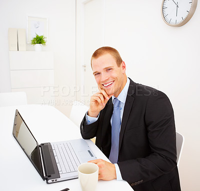 Buy stock photo A young confident business man working on laptop while sitting in the office