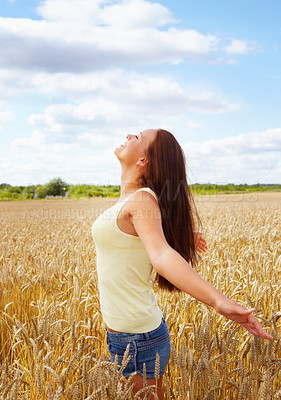 Buy stock photo Profile of a young woman enjoying the freedom of an open crop field