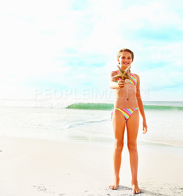 Buy stock photo Full length of a cute young girl holding a starfish while at the sea shore