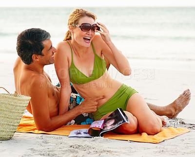 Buy stock photo Mature cute couple in swimwear enjoying themselves at the beach