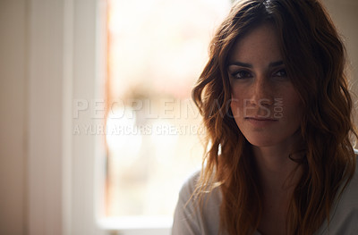 Buy stock photo Cropped portrait of a casual young brunette at home