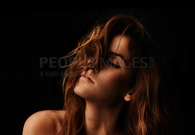 Buy stock photo Closeup of a gorgeous young woman against a dark background