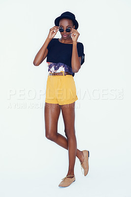 Buy stock photo Studio shot of an African American hipster peering over her sunglasses