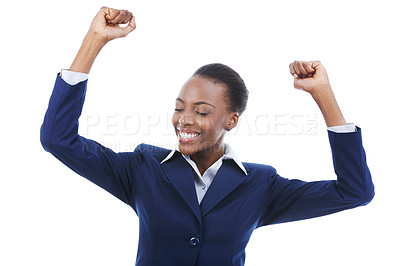 Buy stock photo Shot of a young african american business woman celebrating with her arms raised in the air