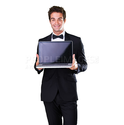 Buy stock photo A young man holding a laptop while wearing a suit and bow tie