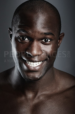 Buy stock photo Portrait of a handsome young man giving you a toothy smile
