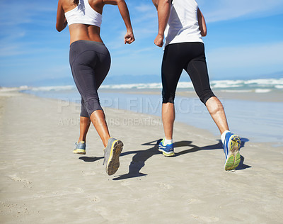 Buy stock photo A couple running at the beach