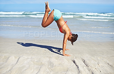 Buy stock photo A young woman doing a handstand