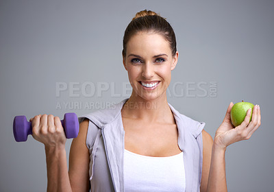 Buy stock photo A young woman working out with weights