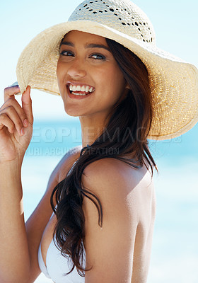 Buy stock photo A gorgeous young woman wearing a sunhat on the beach