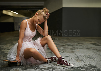 Buy stock photo A young ballerina sitting ona skateboard wearing sneakers