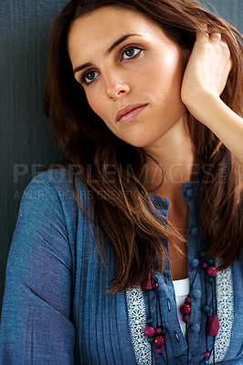 Buy stock photo Pretty young woman posing over grey background
