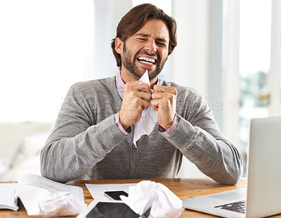 Buy stock photo A handsome businessman crumpling paper in frustration over work stress