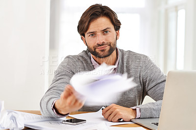 Buy stock photo A handsome businessman throwing his paperwork