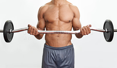 Buy stock photo A muscular man lifting up a barbell