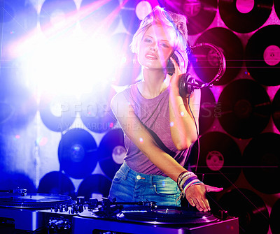 Buy stock photo Shot of a hip young DJ holding her headset looking at the camera